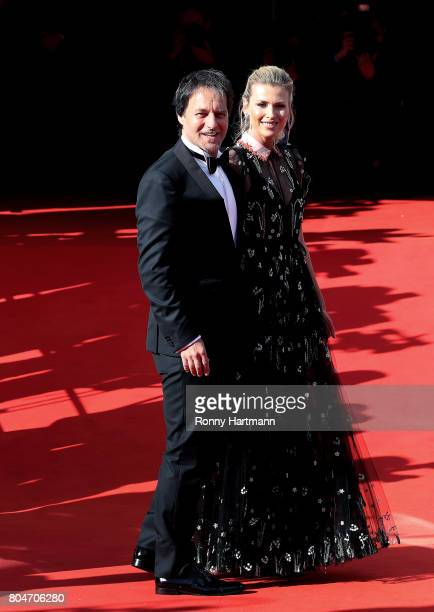 Model Daniela Pestova and her husband Pavol Habera arrive at the opening ceremony of the 52st Karlovy Vary International Film Festival on June 30...