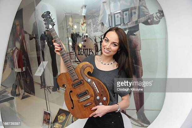 Model Daniella Moyles displays a rare Vox guitar played by George Harrison and John Lennon which is exhibited at the Newbridge Silverware Museum of...