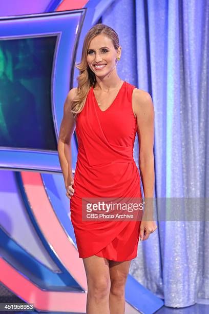 Model Danielle Demski is pretty in red as she waits for her cue to open a door on LET'S MAKE A DEAL airing December 4 on the CBS Television Network