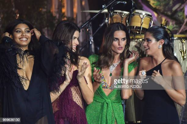 US model Danielle Herrington Brazilian model Isabeli Fontana Brazilian model Izabel Goulart and Portuguese model Sara Sampaio stand on stage during...