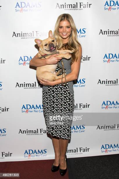 Model Danielle Knudson with dog Almond attends the 12th Annual Animalfaircom Paws For Style Fashion Show at Pacha on May 13 2014 in New York City