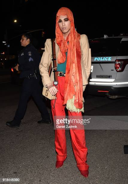 Model Dara Allen is seen wearing a brown jacket and orange pants with red shoes outside the Marc Jacobs show during New York Fashion Week Women's A/W...