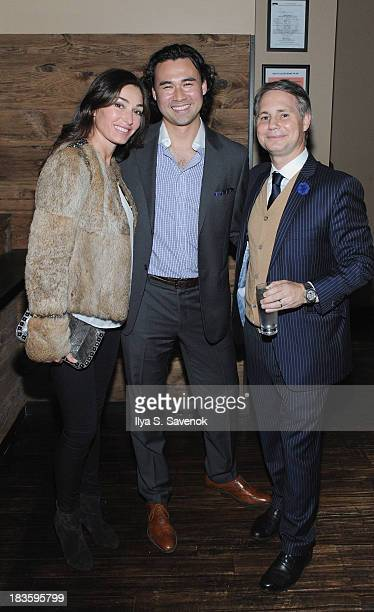 Model Dara Tomanovich pioneer in Asian cuisine Toranosuke Matsuoka and founder of DuJour Media Group Jason Binn pose for a photo as Jason Binn...