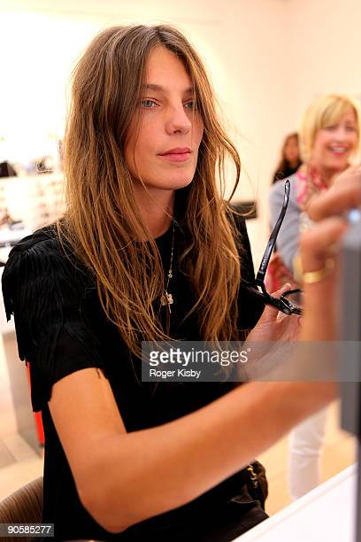 Model Daria Werbowy attends the celebration of Celebrates Fashion's Night Out with Sunglass Hut Vogue Eyewear at Sunglass Hut Times Square on...