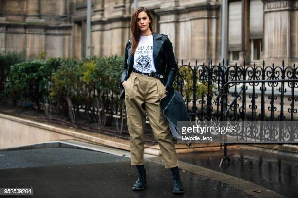 Model Darya Kostenich wears a black leather jacket Balmain You Are Outnumbered Balmain Army tshirt a black belt cargo pants and black boots after the...