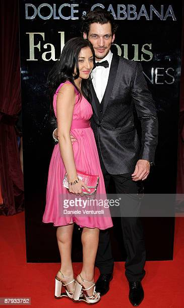 Model David Gandy and guest attend the Dolce Gabbana Party at the Le Baoli Port Canto during the 62nd Annual Cannes Film Festival on May 22 2009 in...