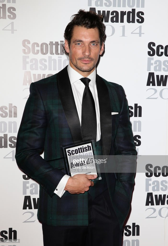 Model David Gandy poses with the Founder's Award as she attends The Scottish Fashion Awards on September 1, 2014 in London, England.