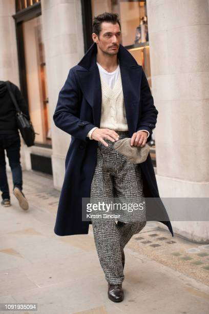 Model David Gandy wears a David Gandy for Marks and Spencers coat Éditions MR trousers Santoni shoes and an Olney hat during London Fashion Week...