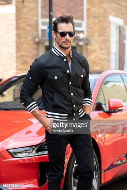 Model David Gandy wears a Dolce and Gabbana jacket during London Fashion Week Men's on June 10 2018 in London England