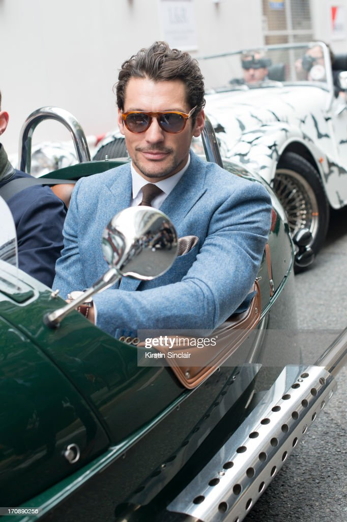 Model David Gandy wears a Reiss suit and Persol sunglasses on day 1 of London Collections: Men on June 16, 2013 in London, England.