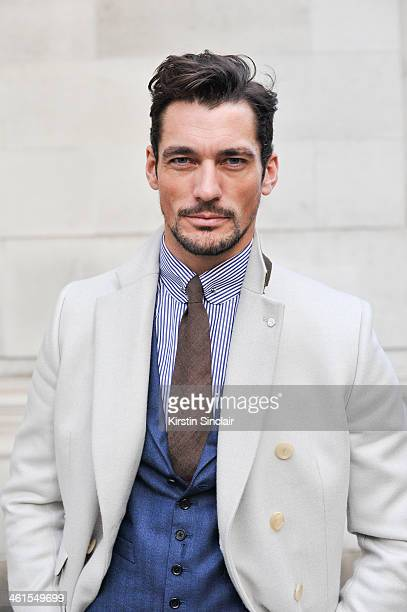 Model David Gandy wears an Eaton shirt, David Gandy by Neil Fennell suit and jacket day 2 of London Mens Fashion Week Autumn/Winter 2014, on January...