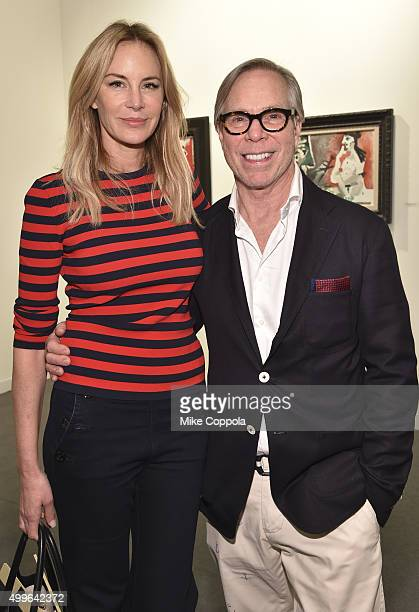 Model Dee Ocleppo and fashion designer Tommy Hilfiger attend the Art Basel Miami Beach VIP Preview at the Miami Beach Convention Center on December 2...