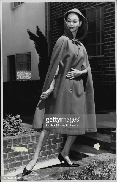 Model Del Hancock wears 'Back Bencher' a cape coat style in soft red wool hooded prettily From the Sports de Jour winter collection March 7 1962
