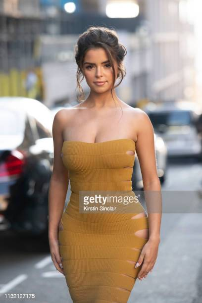 Model Demi Rose Mawby wears a Mark Fast dress and Tom Ford shoes during London Fashion Week February 2019 on February 15 2019 in London England