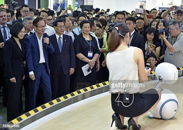 A model demonstrates a ASUS Zenbo robot as Taiwan President Tsai Ingwen looks on during the annual Computex computer exhibition on May 31 2016 More...