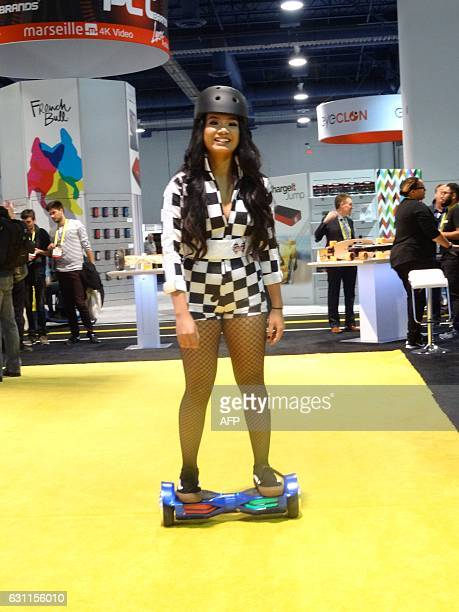 A model demonstrates a Swagtron hoverboard at the Consumer Electronics Show on January 7 2017 in Las Vegas / AFP / Rob Lever