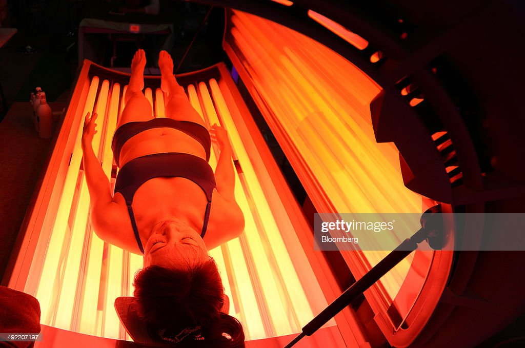 A model demonstrates the Hapro Seecret C200 collagen tube bed at the Beautyworld Japan fair in Tokyo, Japan, on Monday, May 19, 2014. The business-to-business trade fair hosted by Messe Frankfurt is held through May 21. Photographer: Tomohiro Ohsumi/Bloomberg via Getty Images