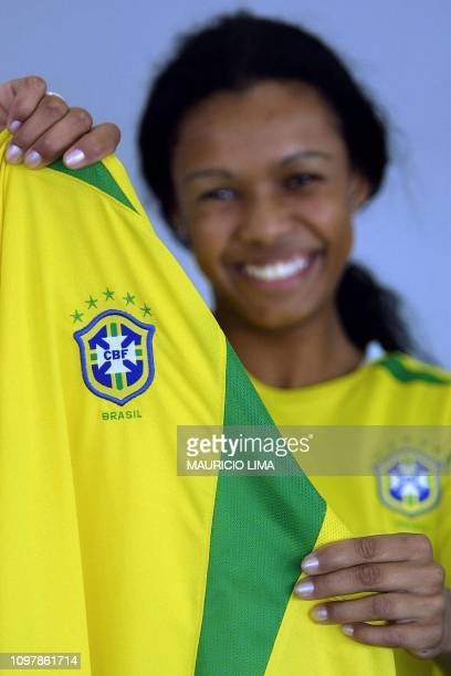A model demonstrates the new official jersey of the Brazilian soccer team with five stars in Sao Paulo Brazil 08 July 2002 AFP PHOTO/Mauricio LIMA...