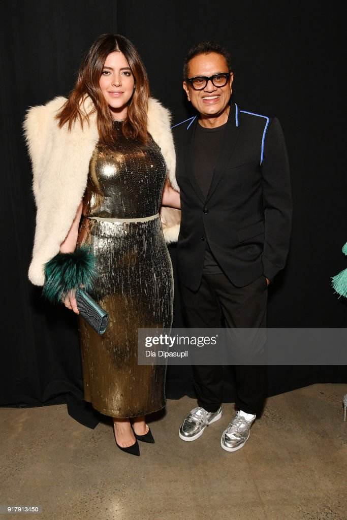 Model Denise Bidot and designer Naeem Khan pose backstage for Naeem Khan during New York Fashion Week: The Shows at Gallery I at Spring Studios on February 13, 2018 in New York City.