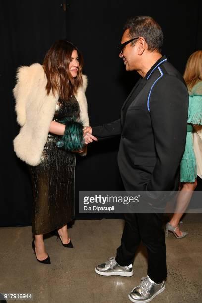 Model Denise Bidot and designer Naeem Khan pose backstage for Naeem Khan during New York Fashion Week The Shows at Gallery I at Spring Studios on...