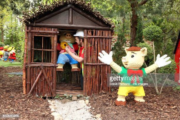 Model designer John Grant puts the finishing touches to the Three Little Pigs scene in the Fairy Tale Brook ride at the LEGOLAND Windsor Resort