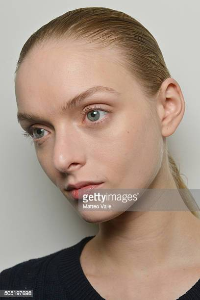 A model detail is seen backstage ahead of the Lucio Vanotti show during Milan Men's Fashion Week Fall/Winter 2016/17 on January 16 2016 in Milan Italy