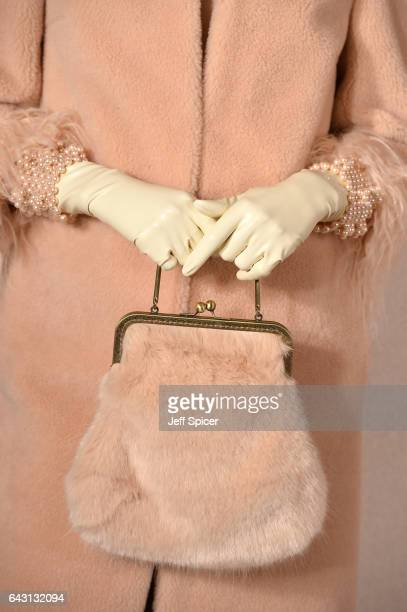 A model detail poses at the Shrimps presentation during the London Fashion Week February 2017 collections on February 20 2017 in London England