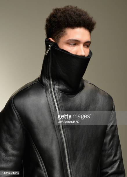 A model detail walks the runway at the DGNAK show during London Fashion Week Men's January 2018 at BFC Show Space on January 8 2018 in London England