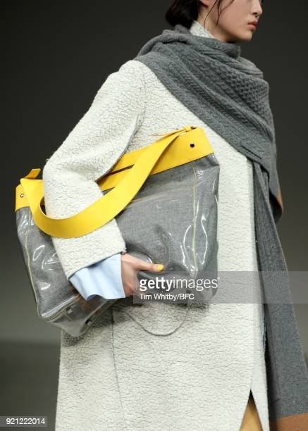 A model detail walks the runway at the Eudon Choi show during London Fashion Week February 2018 on February 20 2018 in London England