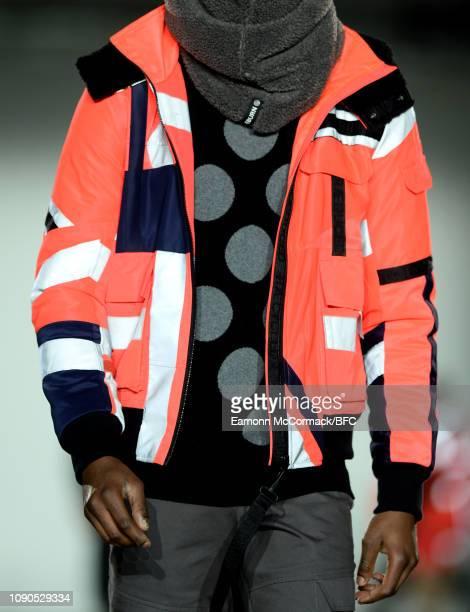A model detail walks the runway at the RAEBURN show during London Fashion Week Men's January 2019 at the BFC Show Space on January 06 2019 in London...