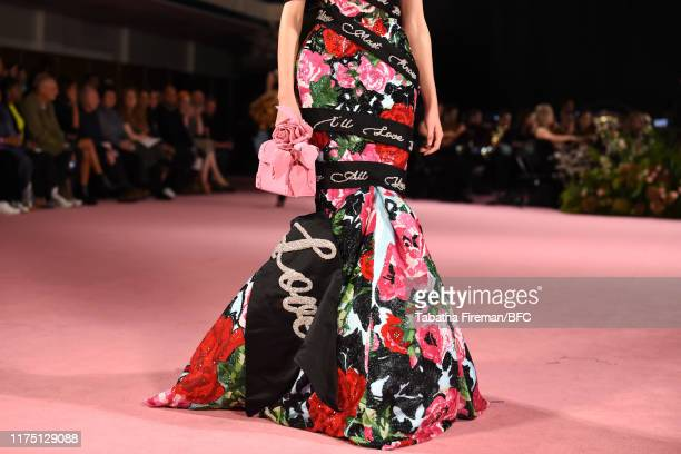 Model, detail, walks the runway at the Richard Quinn show during London Fashion Week September 2019 at York Hall on September 16, 2019 in London,...