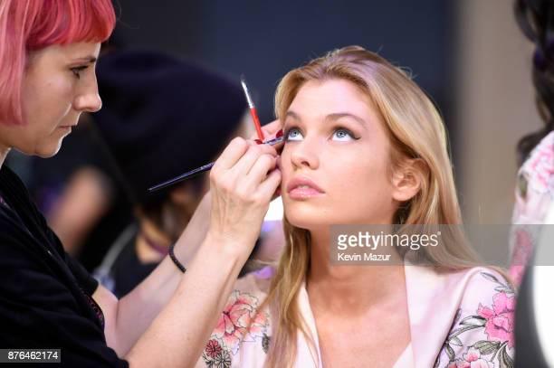 Model Devon Windsor prepares backstage during 2017 Victoria's Secret Fashion Show In Shanghai at MercedesBenz Arena on November 20 2017 in Shanghai...