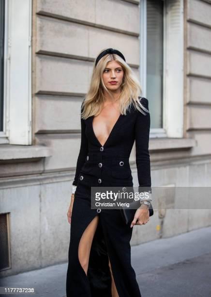 Model Devon Windsor seen wearing black button up dress with slit outside Alessandra Rich during Paris Fashion Week Womenswear Spring Summer 2020 on...