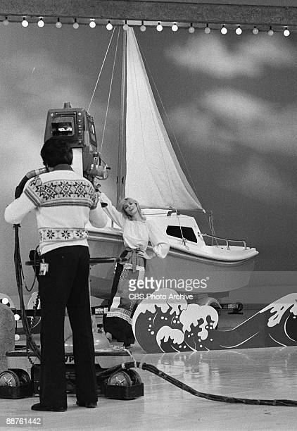 Model Dian Parkinson shows off a sailboat being given away on the CBS game show 'The Price Is Right' February 1978