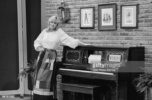 Model Dian Parkinson shows off one of the prizes a piano on the game show 'The Price Is Right' February 1978