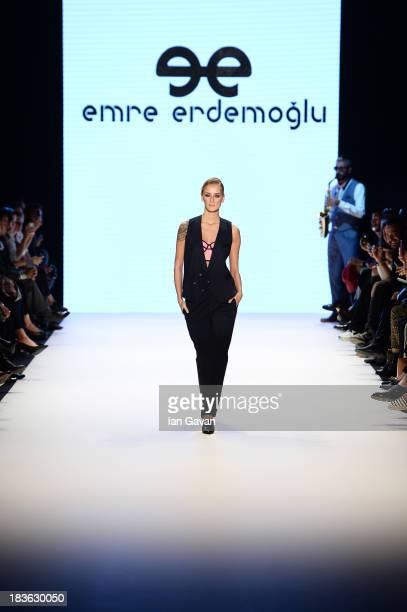 Model Didem Soydan walks the runway at the Emre Erdemoglu show during MercedesBenz Fashion Week Istanbul s/s 2014 presented by American Express on...