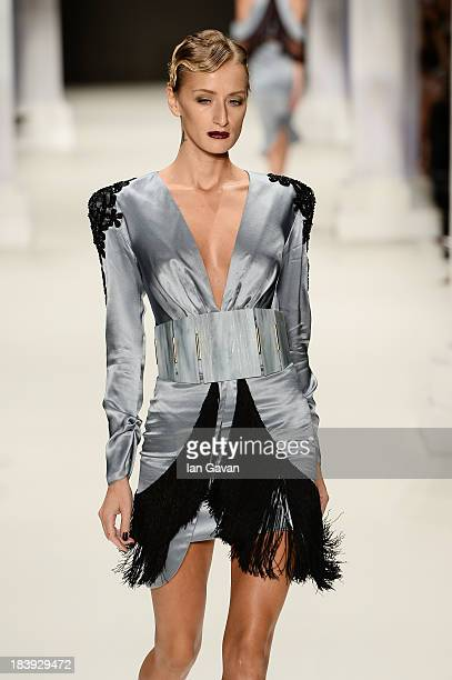 Model Didem Soydan walks the runway at the RaisaVanessa Sason show during MercedesBenz Fashion Week Istanbul s/s 2014 Presented By American Express...