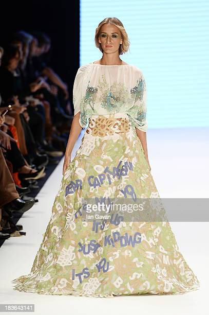 Model Didem Soydan walks the runway at the Red Beard By Tanju Babacan show during MercedesBenz Fashion Week Istanbul s/s 2014 presented by American...