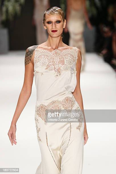 Model Didem Soydan walks the runway at the Tuvanam show during MercedesBenz Fashion Week Istanbul s/s 2014 presented by American Express on October 9...