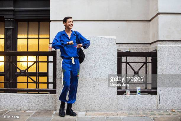 Model Dilone dances and wears a matching indigo blue shirt and pants with flowers during London Fashion Week Spring/Summer 2018 on September 18 2017...