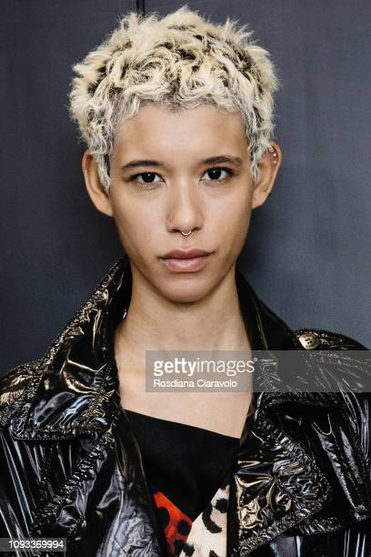 Model Dilone is seen backstage ahead of the Neil Barrett show during Milan Menswear Fashion Week Autumn/Winter 2019/20 on January 12 2019 in Milan...