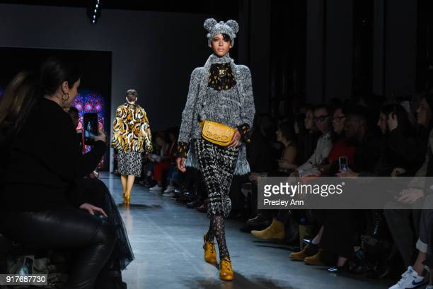 Model Dilone walks the runway at Anna Sui Runway February 2018 New York Fashion Week at Spring Studios on February 12 2018 in New York City
