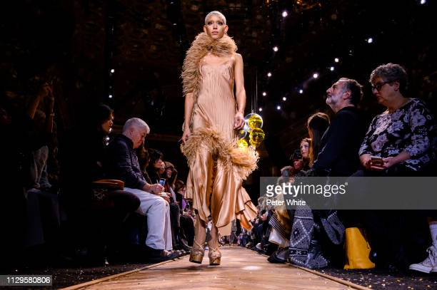 Model Dilone walks the runway at the Michael Kors fashion show during New York Fashion Week on February 13 2019 in New York City