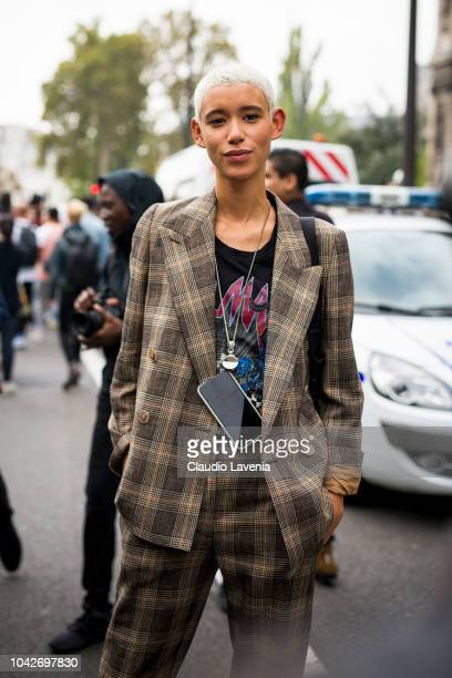 Model Dilone wearing a checked suit and printed tshirt is seen after the Balmain show on September 28 2018 in Paris France
