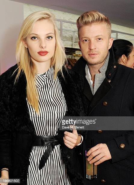 Model Dioni Tabbers and Josh Varney attend the launch of the SuperTrash London flagship store on November 21 2012 in London England