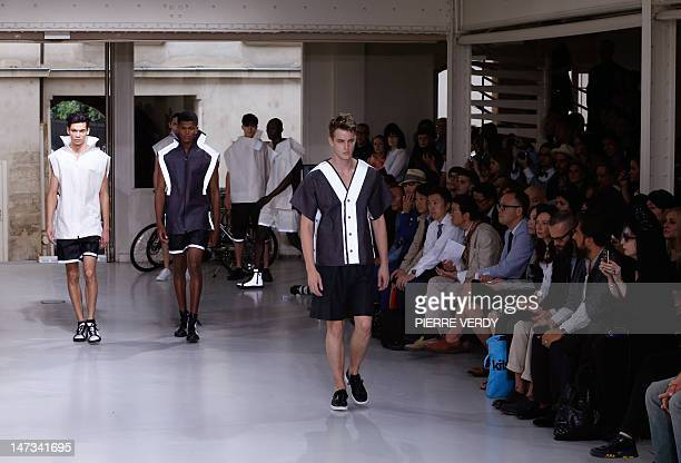 Model display creations for the Japanese label Issey Miyake during the men's spring-summer 2013 fashion collection show on June 28, 2012 in Paris....