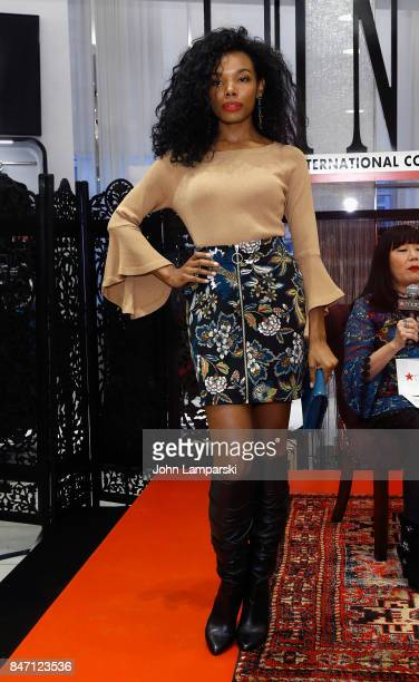 A model displaying fashion attends Macy's celebration of the launch of Anna Sui x INC at Macy's Herald Square on September 14 2017 in New York City