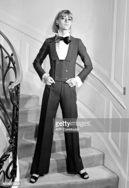 Model displays, 15 February 1967 in Paris, an alpaca dinner jacket spencer, jabot blouse and black silk bow-tie for Yves Saint Laurent 1967...