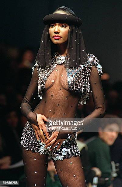 Model displays 30 January 1991 in Paris a revealing blue-silver metallic fish-net mini-dress and top matched for Paco Rabanne 1991 Spring/Summer...