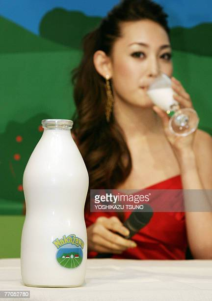 A model displays a bottle of 5000 yen milk Milk for adult produced by Japanese dairy foods maker Nakazawa Foods at the company's headquarters in...